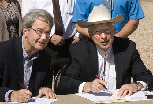 Paul Fraughton / Salt Lake Tribune Bob Abbey, director of the Bureau of Land Management, and Interior Secretary Ken Salazar -- appearing at pipline compressor station in west Salt Lake City -- sign approval for 3,675-well expansion of natural-gas drilling in eastern Utah. Tuesday, May 8, 2012