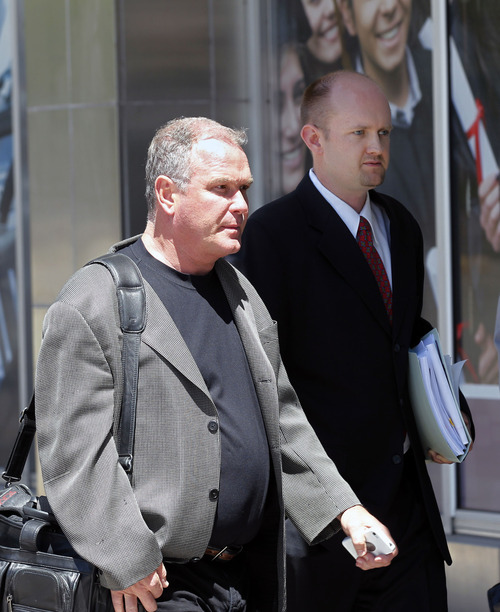 Al Hartmann  |  The Salt Lake Tribune Developer Terry Diehl, left, enters U.S. Trustee Office hearing on Tuesday in Salt Lake City. He faced his creditors at a bankruptcy trustee hearing.
