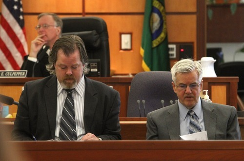 Rick Egan  | The Salt Lake Tribune   Defense attorney Travis Currie (left) sits next to Steve Powell, in the Pierce County Superior Court, in Tacoma, Washington,  Monday, May 7, 2012.   Powell is the father-in-law of missing West Valley City woman Susan Powell. Judge Ronald E. Culpepper is presiding over the estimated eight-day trial on voyeurism and pornography charges.