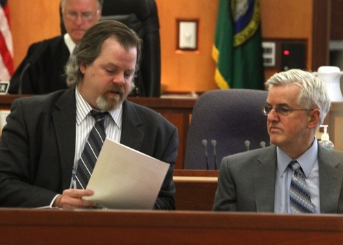 Rick Egan  | The Salt Lake Tribune   Defense attorney Travis Currie (left) talks to Steve Powell, in the Pierce County Superior Court, in Tacoma, Washington,  Monday, May 7, 2012.   Powell is the father-in-law of missing West Valley City woman Susan Powell. Judge Ronald E. Culpepper is presiding over the estimated eight-day trial on voyeurism and pornography charges.