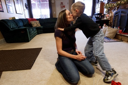 Trent Nelson  |  The Salt Lake Tribune T.J. Carver kisses his mother, Jen Carver, when she picks him up from day care, Thursday, March 29, 2012 in Ogden, Utah. Carver served two tours in Iraq and is now a full-time college student with an on-campus job while raising her 4-year-old son.