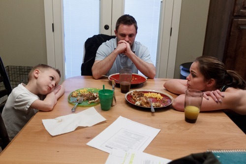 Trent Nelson  |  The Salt Lake Tribune T.J. Carver, left, stares back at his mother, Jen Carver, at the dinner table Wednesday, March 28, 2012 in Ogden, Utah. Daniel Comer, Carver's fiancé, is at center. Carver served two tours in Iraq and is now a full-time college student with an on-campus job while raising her 4-year-old son.