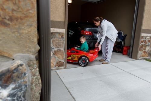 Trent Nelson  |  The Salt Lake Tribune Jen Carver helps her son T.J. back his electric car out of the garage Wednesday, March 28, 2012 in Ogden, Utah. U.S. Army veteran Jen Carver served two tours in Iraq and is now a full time college student with an on-campus job while raising her 4-year-old son. After a long day of school and work, Carver keeps her evenings as,
