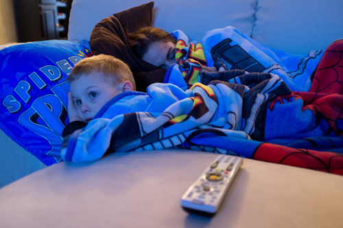 Trent Nelson  |  The Salt Lake Tribune After a long day of school and work, Jen Carver falls asleep for a quick nap as her son T.J. watches television Thursday, March 29, 2012 in Ogden, Utah. U.S. Army veteran Jen Carver served two tours in Iraq and is now a full time college student with an on-campus job while raising her 4-year-old son.