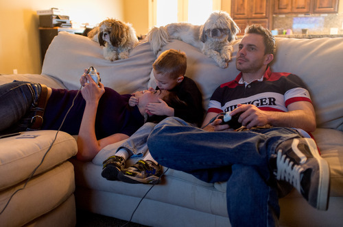 Trent Nelson  |  The Salt Lake Tribune T.J. Carver kisses his mother, Jen Carver, during a family videogame session Thursday, March 29, 2012 in Ogden, Utah. Carver's fiancé Daniel Comer is at right. U.S. Army veteran Jen Carver served two tours in Iraq and is now a full time college student with an on-campus job while raising her 4-year-old son. After a long day of school and work, Carver keeps her evenings as,