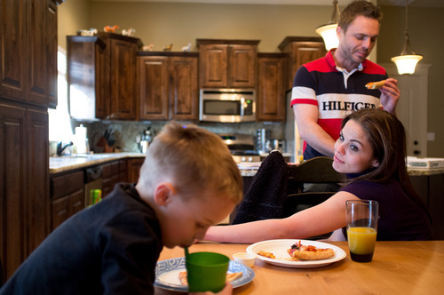 Trent Nelson  |  The Salt Lake Tribune Jen Carver looks on as her son T.J. has dinner Thursday, March 29, 2012 in Ogden, Utah. Carver's fiancé Daniel Comer is at right. U.S. Army veteran Jen Carver served two tours in Iraq and is now a full time college student with an on-campus job while raising her 4-year-old son. After a long day of school and work, Carver keeps her evenings as,