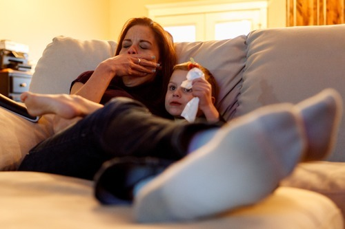Trent Nelson  |  The Salt Lake Tribune Jen Carver yawns while watching television with her son, T.J., Thursday, March 29, 2012 in Ogden, Utah. The Army veteranserved two tours in Iraq and is now a full-time college student with an on-campus job while raising her 4-year-old son. After a long day of school and work, Carver keeps her evenings as