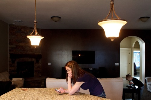 Trent Nelson  |  The Salt Lake Tribune Jen Carver checks her phone after a long day of school and work, Thursday, March 29, 2012 in Ogden, Utah.  Jen Carver served two tours in Iraq and is now a full-time college student with an on-campus job while raising her 4-year-old son.