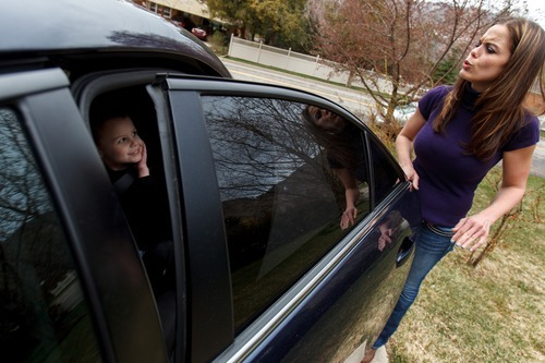 Trent Nelson  |  The Salt Lake Tribune Jen Carver blows a kiss to her son, T.J., while picking him up from day care, Thursday, March 29, 2012 in Ogden, Utah. U.S. Army veteran Jen Carver served two tours in Iraq and is now a full-time college student with an on-campus job while raising her 4-year-old son.
