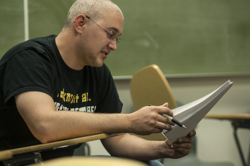 Chris Detrick  |  The Salt Lake Tribune Army veteran John Gruendell reads his poem in Maximilian Werner's class 'Writing about War' at the University of Utah Tuesday April 17, 2012.