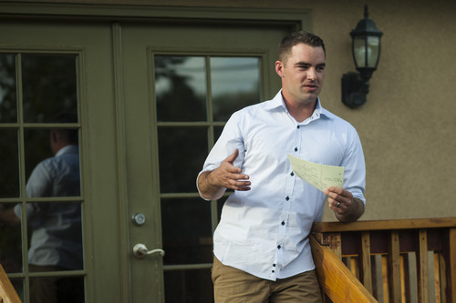 Chris Detrick  |  The Salt Lake Tribune Navy veteran Dillon Ely talks about his experiences in the military during a gathering at professor Maximilian Werner's house Tuesday April 24, 2012.