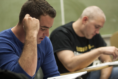 Chris Detrick  |  The Salt Lake Tribune Navy veteran Dillon Ely reads his poem in Maximilian Werner's class 'Writing about War' at the University of Utah Tuesday April 17, 2012.