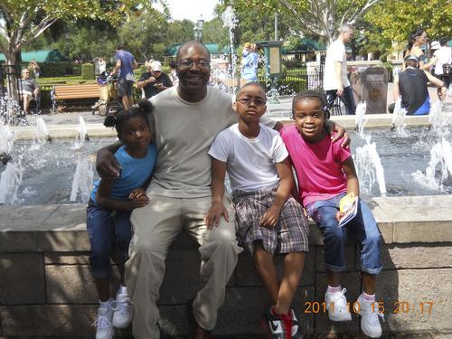 Courtesy Chris Carlton Chris Carlton is helping raise his daugthers Ambur, 6, left, and Ashira, 8, and stepson Micheal.
