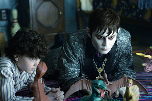 In this film image released by Warner Bros., Gully McGrath portrays David Collins, left, and Johnny Depp portrays Barnabas Collins in a scene from