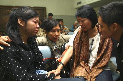 Relatives weep as they wait for news on the missing Russian airplane at Halim Perdanakusuma Airport in Jakarta, Indonesia, Thursday, May 10, 2012. The wreckage of the Sukhoi Superjet-100 passenger plane that went missing during a demonstration flight Wednesday near Jakarta was spotted Thursday in a mountainous area of West Java, according to media reports. (AP Photo/Tatan Syuflana)