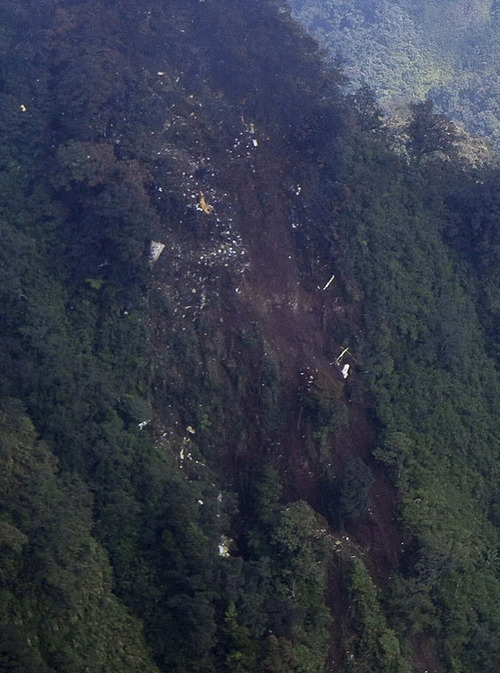 In this picture released by Indonesian Air Force,  the wreckage of a missing Sukhoi Superjet-100 are scattered on the mountainside in Bogor, West Java, Indonesia, Thursday, May 10, 2012. The new Russian-made passenger plane disappeared Wednesday during a demonstration flight with 47 people on board. (AP Photo/Indonesian Air Force)