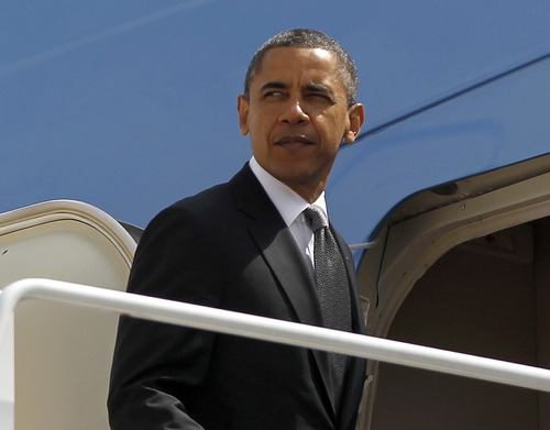 President Barack Obama prepares to board Air Force One before his departure from Andrews Air Force Base, Tuesday, May, 8, 2012. (AP Photo/Pablo Martinez Monsivais)
