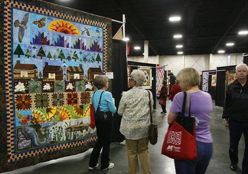 Scott Sommerdorf  |  The Salt Lake Tribune              Visitors admire the quilt