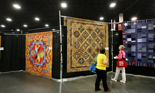 Scott Sommerdorf  |  The Salt Lake Tribune              Visitors to the Ninth annual Home Machine Quilting Show (HMQS), peruse quilts on display at the South Towne Exposition Center, Thursday, May 10, 2012.