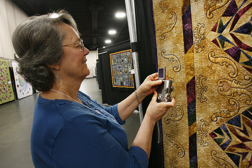Scott Sommerdorf  |  The Salt Lake Tribune              Judy Redding, of Kansas City, MO, makes a photo of some of the detailed stiching in