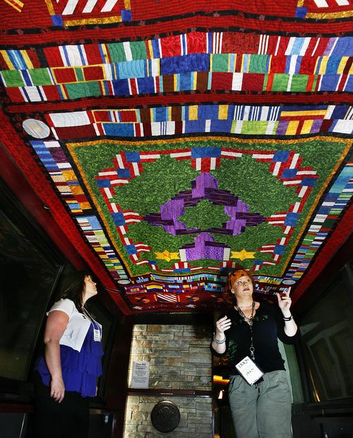 Scott Sommerdorf  |  The Salt Lake Tribune              Quilters Janetta Killough of Ogden, left, and Bridgette Stein speak about the quilt