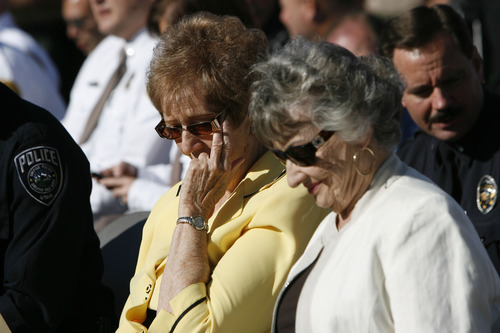 Francisco Kjolseth  |  The Salt Lake Tribune Jean Wawrzyniak, left, wife of fallen Deputy Melvin Colebrook who was killed in the line of duty on March 10, 1973, is accompanied by her former husbands sister Phyllis Harries as they attend a memorial service for fallen officers. Salt Lake County Sheriff's and Unified Police gathered to honor those fallen members at a memorial service during a short program at the Salt Lake County Sheriff's Office on Wednesday, May 9, 2012.