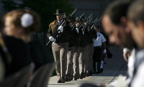 Francisco Kjolseth  |  The Salt Lake Tribune Salt Lake County Sheriff's Honor Guard is joined by Unified Police to honor fallen members at a memorial service during a short program at the Salt Lake County Sheriff's Office on Wednesday, May 9, 2012.