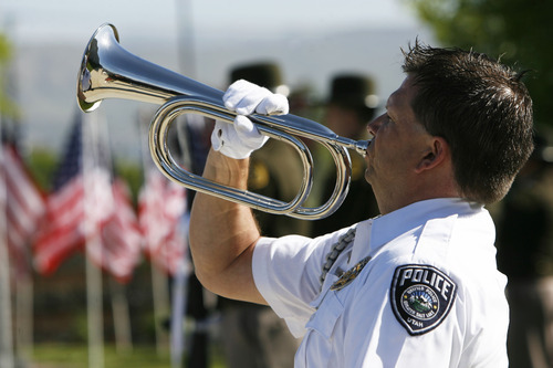 Francisco Kjolseth  |  The Salt Lake Tribune Officer Chris Christensen plays Taps as Salt Lake County Sheriff's and Unified Police honor fallen members at a memorial service during a short program at the Salt Lake County Sheriff's Office on Wednesday, May 9, 2012.