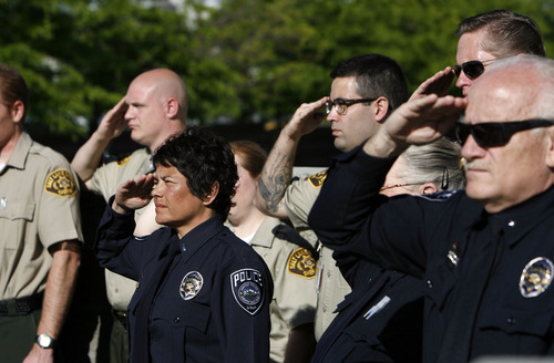 Francisco Kjolseth  |  The Salt Lake Tribune Salt Lake County Sheriff's and Unified Police honor fallen members at a memorial service during a short program at the Salt Lake County Sheriff's Office on Wednesday, May 9, 2012.