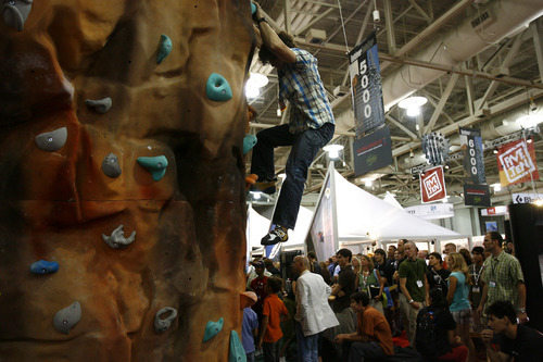 Salt Lake City, UT--8/9/07--2:11:22 PM-- Garret Gregor, 20, of Upland, Cal., climbs the wall at the Climbers' Ranch exhibit at the Outdoor Retailers convention at the Salt Palace.  ****************************** Outdoor Retailers convention opening. The story will focus on a noon session at the Marriott about how kids are not engaging in outdoor activities like their parents, meaning industry is losing to video games, etc. But a generic shot of the crowds descending on the Salt Palace or retailers setting up could work too.  Chris Detrick/The Salt Lake Tribune File #_1CD7201    `