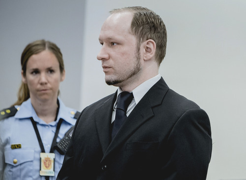 Anders Behring Breivik, who has admitted to the July 22, 2011 massacre and a bombing in Oslo that killed eight people earlier that day, stands with a police woman in court in Oslo Thursday May 10, 2012.    (AP Photo/Krister Sorbo/NTB Scanpix, Pool)