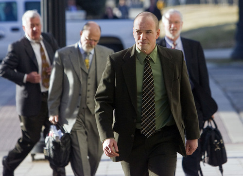 Al Hartmann  |  The Salt Lake Tribune  Tim DeChristopher arrives with his legal team at the Frank Moss Federal Courthouse on Wednesday.