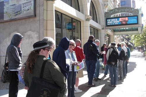 People wait in line outside the Capitol Theatre in Salt Lake City on Friday to buy tickets to the