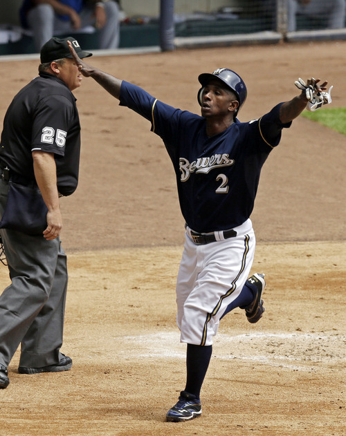 Milwaukee Brewers' Nyjer Morgan reacts after scoring during the first inning of a baseball game against the Chicago Cubs on Saturday, May 12, 2012, in Milwaukee. Morgan scored from third after a pick-off attempt on Ryan Braun at first. (AP Photo/Morry Gash)