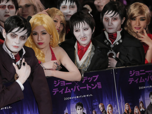 Japanese fans wait for the arrival of actor Johnny Depp and Director Tim Burtont at the premiere of
