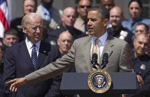 President Barack Obama with Vice President Joe Biden, left, honors the 2012 National Association of Police Organizations TOP COPS award winners in the Rose Garden at the White House, Saturday, May 12, 2012.  (AP Photo/Manuel Balce Ceneta)