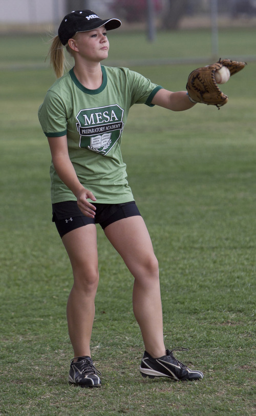 Paige Sultzbach, 15, catches a baseball in Mesa, Ariz. on May 9, 2012. Our Lady of Sorrows has bowed out of Thursday night's game against Mesa Preparatory Academy in the Arizona Charter Athletic Association championship, rather then face a team with a female player.  Sultzbach, plays second base at Mesa Prep.  (AP Photo/The Arizona Republic, Carlos Chavez)  MARICOPA COUNTY OUT; MAGS OUT; NO SALES