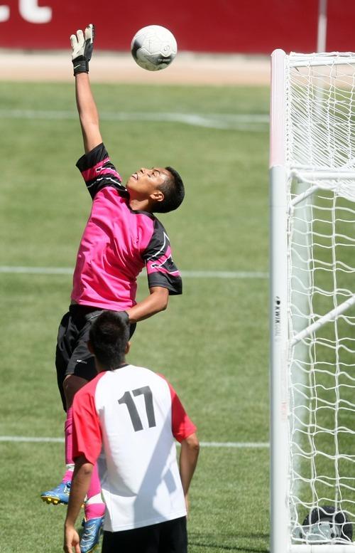 Chris Detrick  |  The Salt Lake Tribune Manti's Antonio Jimenez (13) makes a save during the 2A soccer championship game at Rio Tinto Stadium Saturday May 12, 2012. Manti won the game 3-2.