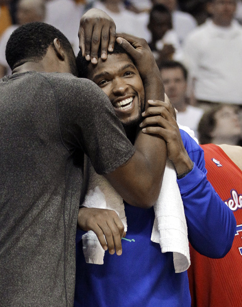 Los Angeles Clippers center DeAndre Jordan, left, hugs teammate Ryan Gomes, right, in final seconds of the second half of Game 7 against the Memphis Grizzlies in a first-round NBA basketball playoff series on Sunday, May 13, 2012, in Memphis, Tenn. The Clippers won 82-72 to take the series 4-3. (AP Photo/Mark Humphrey)