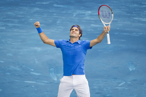 Roger Federer from Switzerland celebrates after defeating Tomas Berdych from the Czech Republic during their singles men's final tennis match at the Madrid Open tennis tournament in Madrid Sunday, May 13, 2012. (AP Photo/Daniel Ochoa de Olza)