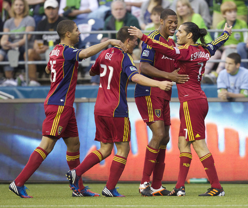 Real Salt Lake's Fabian Espi´ndola, far right, celebrates scoring a goal with teammates, from left, Alvaro Saborio, Luis Gil and Chris Schuler during the second half of play in a MLS soccer match, Saturday, May 12, 2012, in Seattle. Real Salt Lake won the match 1-0. (AP PHOTO/Stephen Brashear)