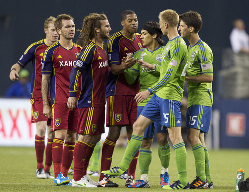 Real Salt Lakes Kyle Beckerman, third from left, and Chris Schuler confront Andy Rose, second from right and Alvaro Fernandez, far right, while Fredy Montero tries to intervene during the second half of play in a MLS soccer match, Saturday, May 12, 2012, in Seattle. Real Salt Lake won the match 1-0. At far left is Real Salt Lake's Nat Borchers and Jonny Steele. (AP PHOTO/Stephen Brashear)