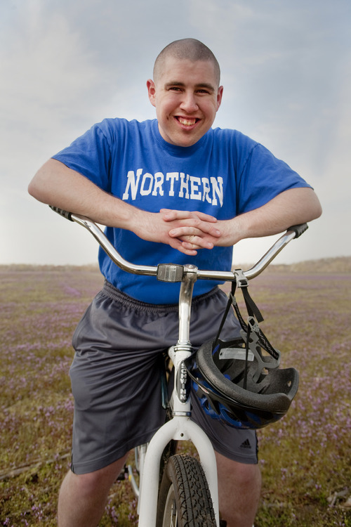 In this March 2011 photo provided by Jeff Martin, Ian Wells sits on a bicycle in North Hanover, N.J. Wells, 21, of Allentown, N.J., has autism and has had trouble finding paid employment. A study being published Monday in Pediatrics says 1 in 3 young adults with autism have no jobs or college or technical school education nearly seven years after high school, and fare worse than those with other disabilities.  (AP Photo/Courtesy of Jeff Martin)