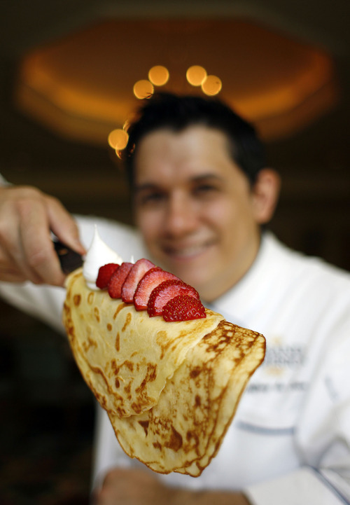 Francisco Kjolseth  |  The Salt Lake Tribune Jeffrey de Leon, executive pastry chef at the Grand America Hotel in Salt Lake City, knows how to make a tasty crepe and demonstrates how easy it is to assemble one of these French delicacies. The Grand America will be making hundreds of crepes for its Mother's Day holiday buffet.