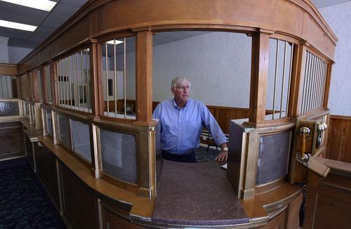 Steve Griffin/The Salt Lake Tribune   Milton Hanks, mayor of Eureka, stands behind the counter of the historic Eureka bank.