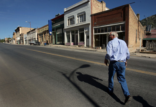 Steve Griffin/The Salt Lake Tribune   Mayor Milton Hanks walks up Highway 6, which is the main street in Eureka. The plain-spoken leader has trust issues with some of the business owners in the former mining town.