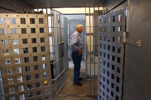 Steve Griffin/The Salt Lake Tribune   Milton Hanks, mayor of Eureka, stands in the old county jail, which is part of the Eureka City Offices in Eureka, Utah Wednesday May 9, 2012.