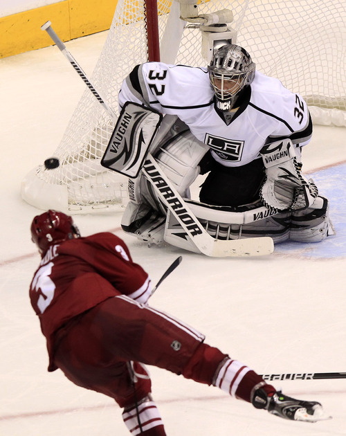 Ross D. Franklin | The Associated Press Los Angeles Kings' Jonathan Quick (32) makes a save on a shot by Phoenix Coyotes' Keith Yandle (3) during the third period of Game 1 of the NHL hockey Stanley Cup Western Conference finals, Sunday, May 13, 2012, in Glendale, Ariz.  The Kings defeated the Coyotes 4-2.(AP Photo/Ross D. Franklin)