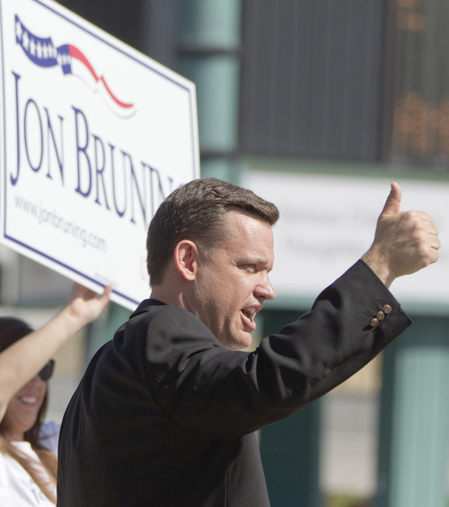 Nebraska Attorney Gen. Jon Bruning responds to encouragement from a passing motorists in Omaha, Neb., Tuesday, May 15, 2012. Bruning is competing against state Senator Deb Fischer and state Treasurer Don Stenberg in the Republican primary election for the U.S. Senate seat vacated by democrat Ben Nelson. (AP Photo/Nati Harnik)