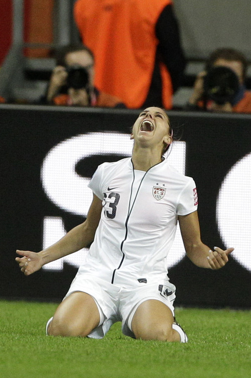 United States' Alex Morgan celebrates scoring the opening goal during the final match between Japan and the United States at the Women's Soccer World Cup in Frankfurt, Germany, Sunday, July 17, 2011. (AP Photo/Frank Augstein)